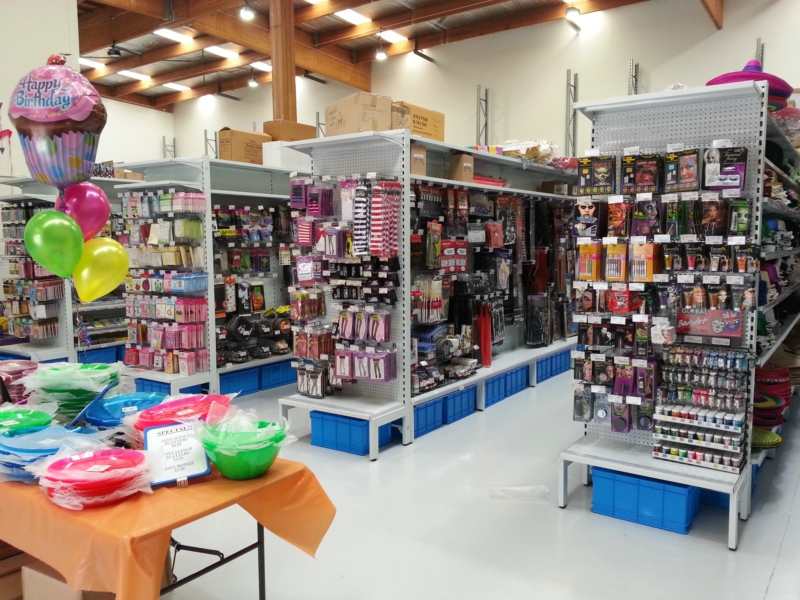 Pegboard shelving for party shop